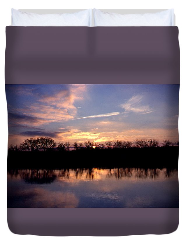 Sunset Duvet Cover featuring the photograph The Moment by Charles Wood II