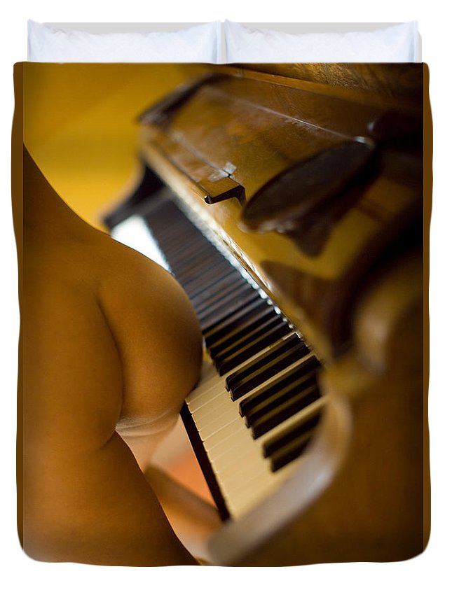 Sensual Duvet Cover featuring the photograph The Piano by Olivier De Rycke