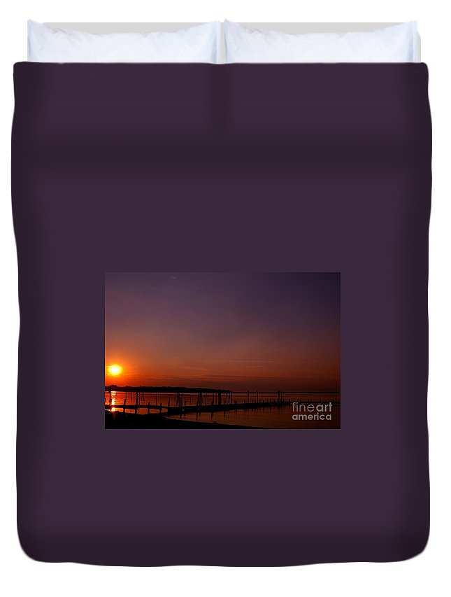 Clay Duvet Cover featuring the photograph The Sun Sets Over The Water by Clayton Bruster