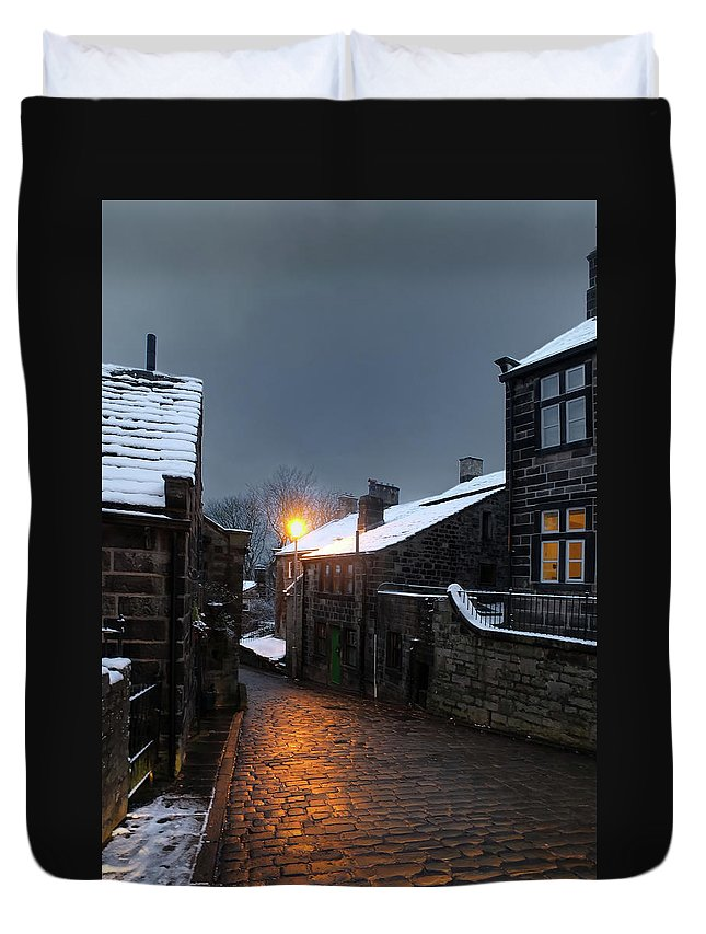 Heptonstall Duvet Cover featuring the photograph The Village Of Heptonstall In The Snow At Night With Lamps Shini by Philip Openshaw