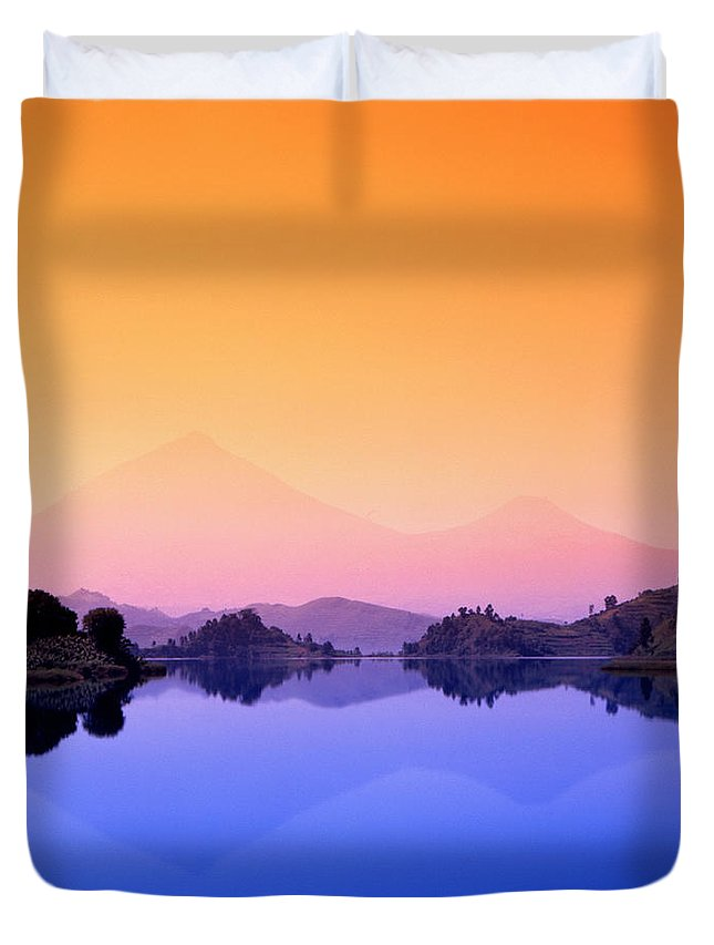 Lake Mutanda Duvet Cover featuring the photograph The Virunga Mountains Rise Above Lake by David Pluth