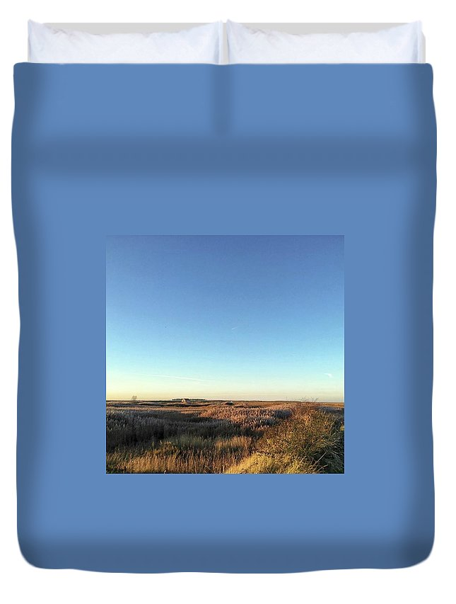 Natureonly Duvet Cover featuring the photograph Thornham Marsh Lit By The Setting Sun by John Edwards