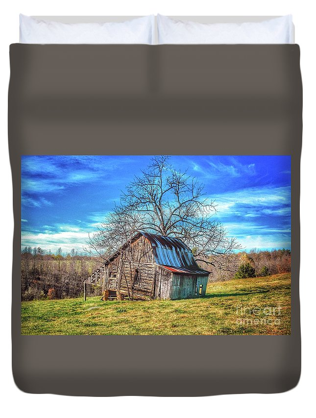 Tiled Forward Duvet Cover featuring the photograph Tilted Log Cabin by John Myers