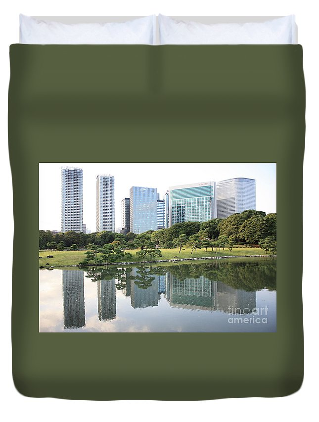 Tokyo Duvet Cover featuring the photograph Tokyo Skyline Reflection by Carol Groenen