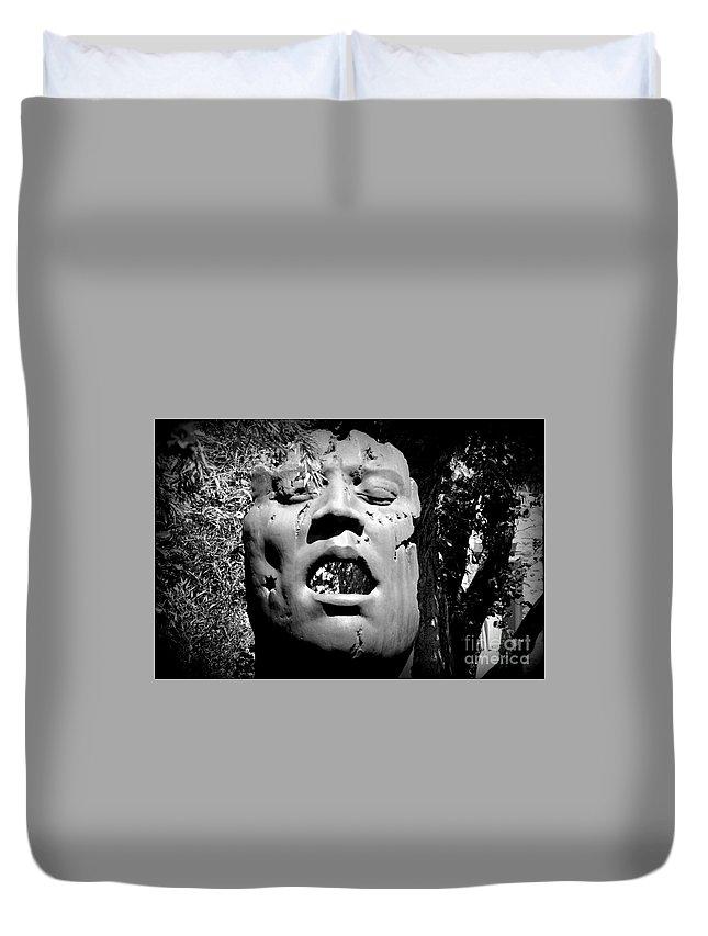 Outdoor Sculpture Duvet Cover featuring the photograph Torn by Bernd Billmayer