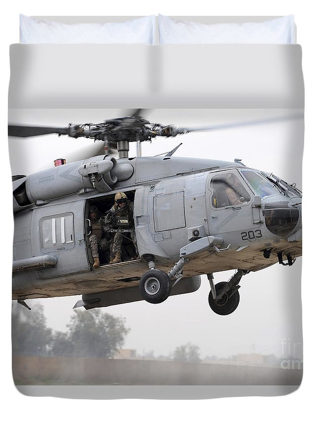 Muqdadiyah Duvet Cover featuring the photograph U.s. Special Forces Conduct Assault by Stocktrek Images