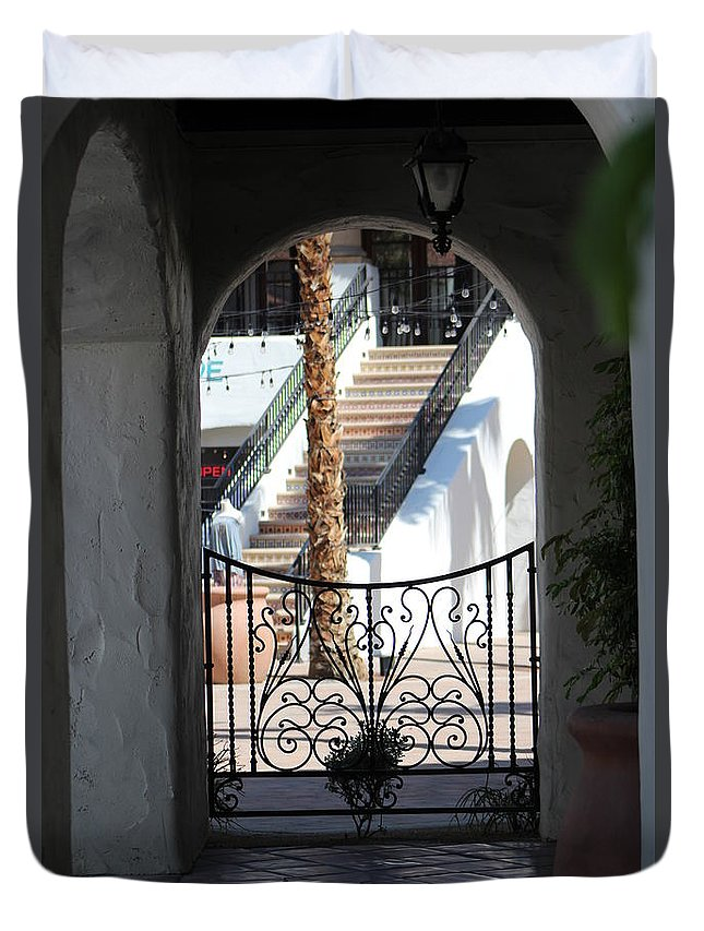 Adobe Duvet Cover featuring the photograph View of Art District Courtyard Through Stucco Doorway by Colleen Cornelius