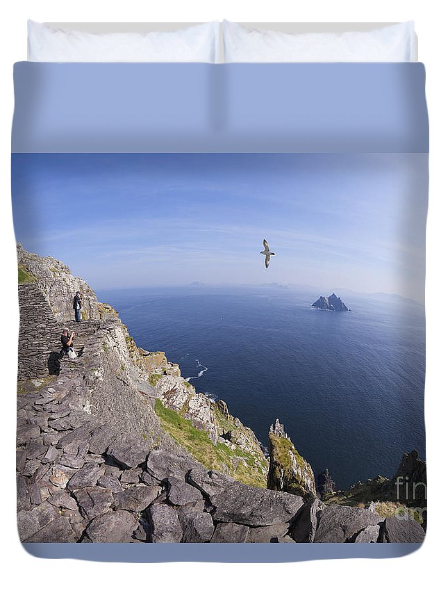 Visitors Duvet Cover featuring the photograph Visitors Admire Celtic Monastery, Skellig Michael, Looking To Little Skellig, County Kerry, Ireland by Peter Barritt