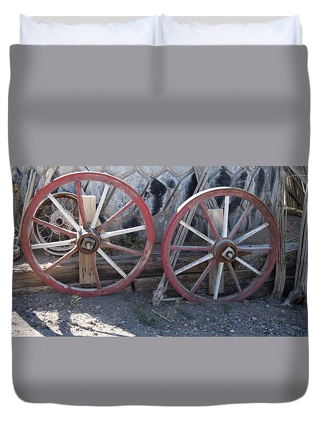 Wheels Duvet Cover featuring the photograph Wagon Wheels. by Robert Rodda