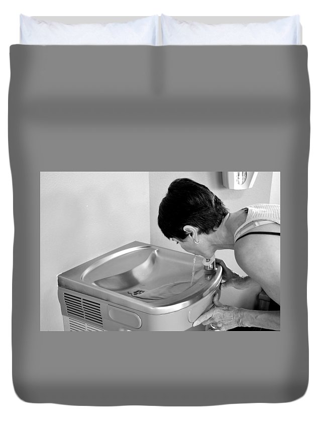 Mature Duvet Cover featuring the photograph Water Fountain. by Oscar Williams