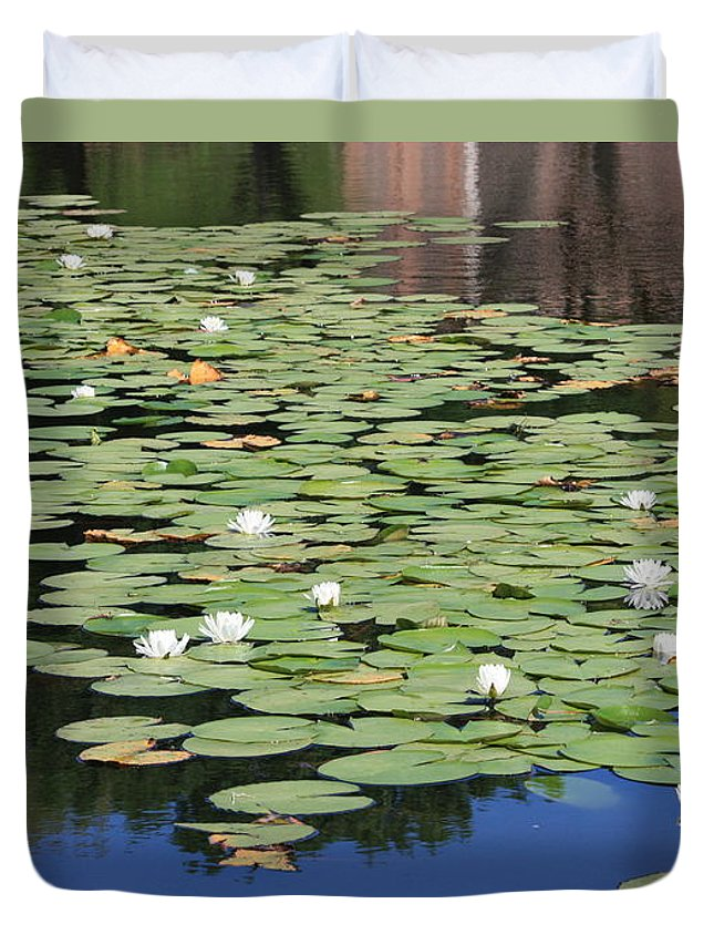 Water Duvet Cover featuring the photograph Water Lily Pond by Carol Groenen