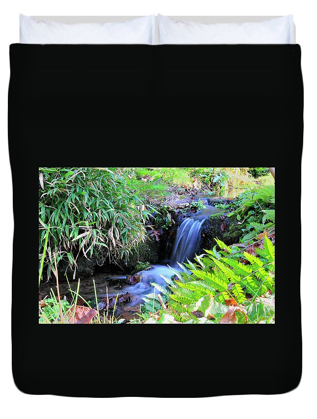 Water. Waterfall Duvet Cover featuring the photograph Waterfall In The Fern Garden by David Arment