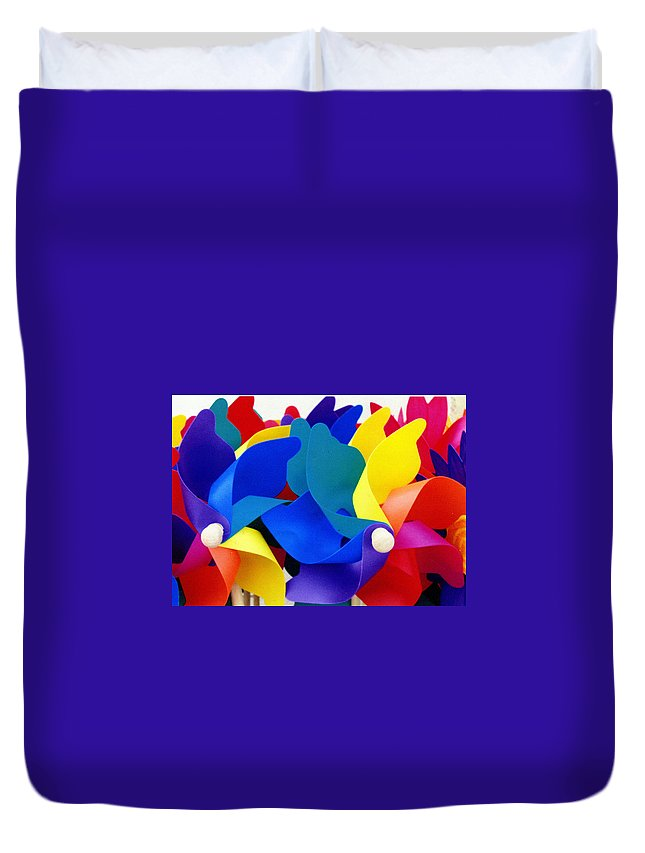 Toy Duvet Cover featuring the photograph What Goes Around by Wayne Potrafka