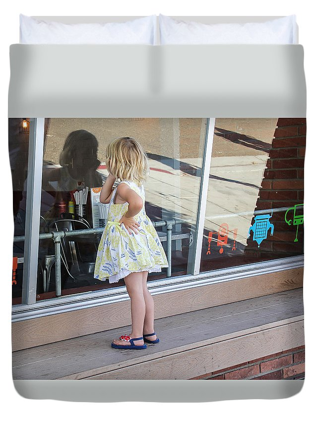 Little Girl Looking In Store Window Duvet Cover featuring the photograph What's In There? by Mary Ourada