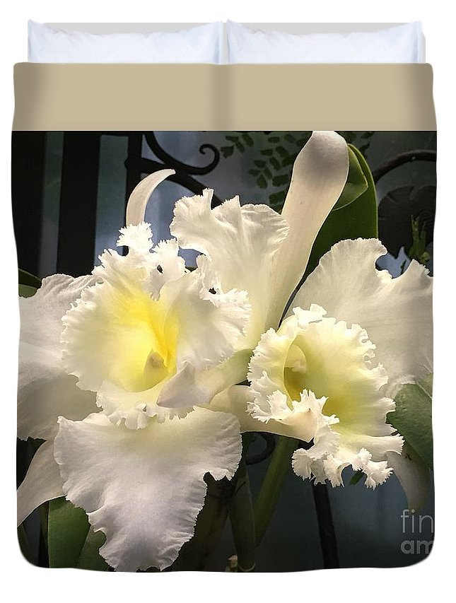 Art Duvet Cover featuring the photograph White With Yellow Orchids by Jeannie Rhode