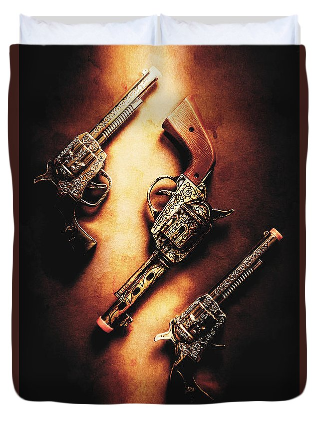Toy Duvet Cover featuring the photograph Wild West Cap Guns by Jorgo Photography - Wall Art Gallery