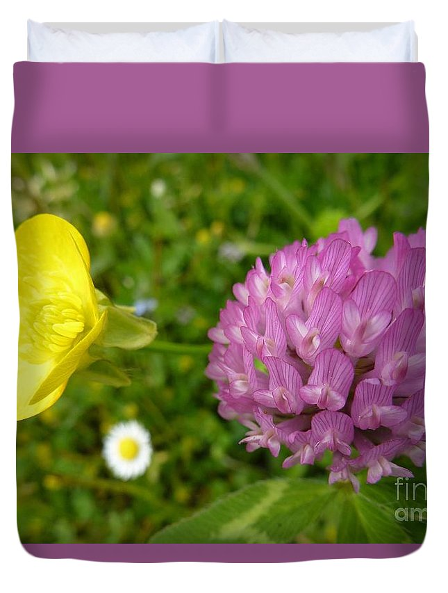 A Path Of Petals Duvet Cover featuring the photograph Yellow And Purple Flowers by Jean Bernard Roussilhe