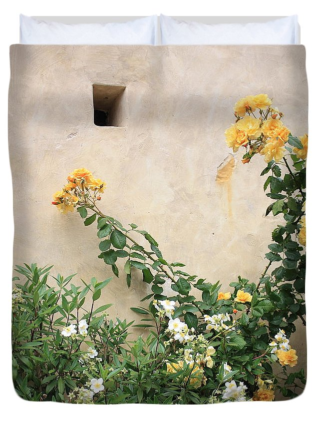 Yellow Roses Duvet Cover featuring the photograph Yellow Roses And Tiny Window At Carmel Mission by Carol Groenen