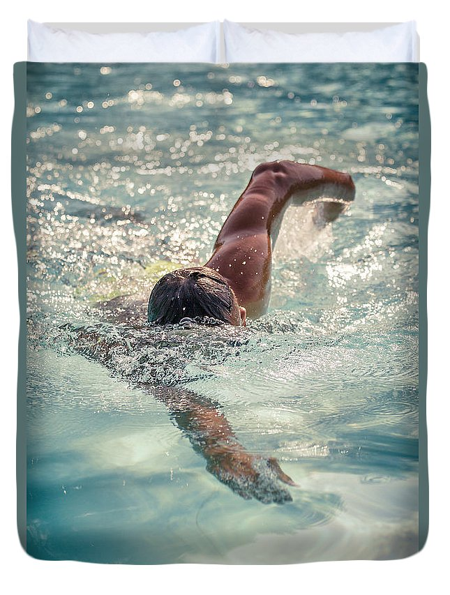 One Man Duvet Cover featuring the photograph Young Man Swimming by Pier Giorgio Mariani