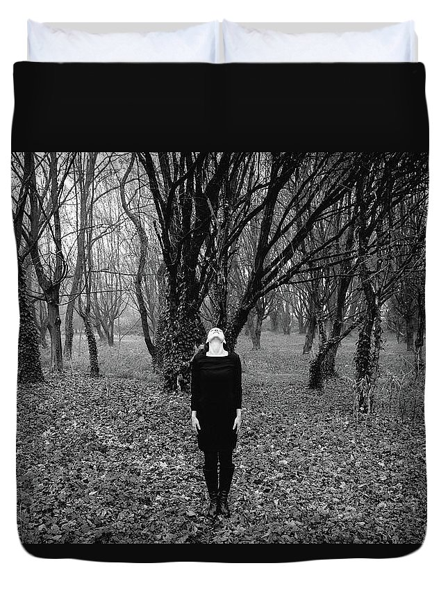 30-35 Years Duvet Cover featuring the photograph Young Woman With Her Head Tilted Back While Standing In A Forest by Alexandre Rotenberg