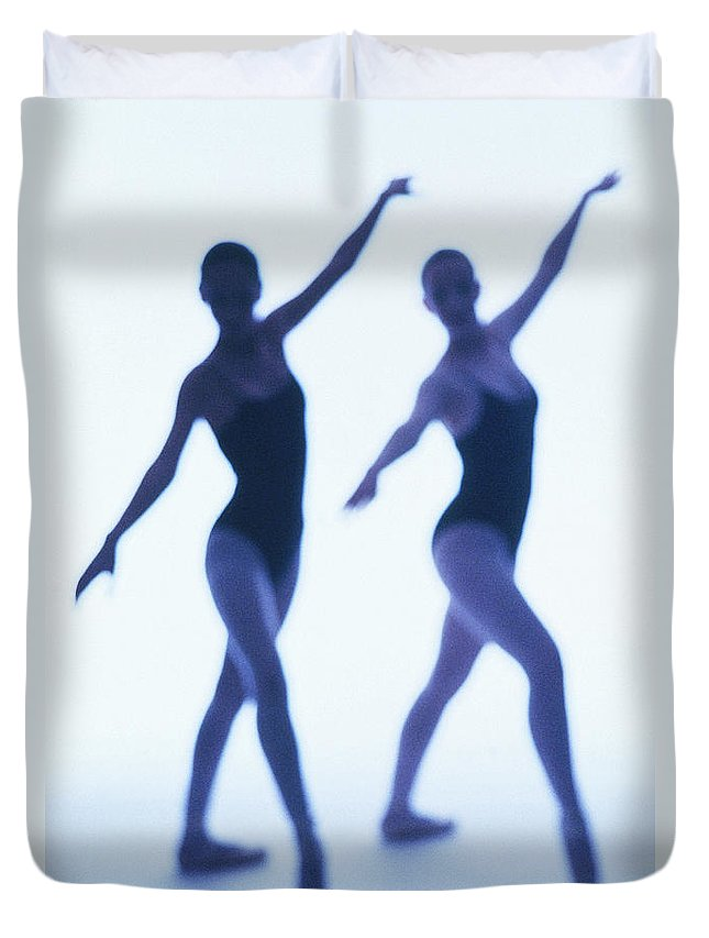 Ballet Dancer Duvet Cover featuring the photograph A Silhouette Of Two Young Women by George Doyle