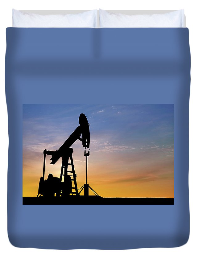 Dawn Duvet Cover featuring the photograph Dawn Over Petroleum Pumps In The Desert by Grafissimo