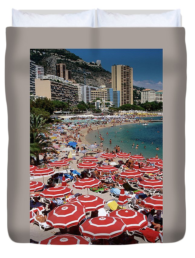 Shadow Duvet Cover featuring the photograph Overhead Of Red Sun Umbrellas At by Dallas Stribley