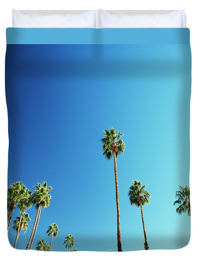 Clear Sky Duvet Cover featuring the photograph Palm Trees Against Blue Sky by Micha Pawlitzki