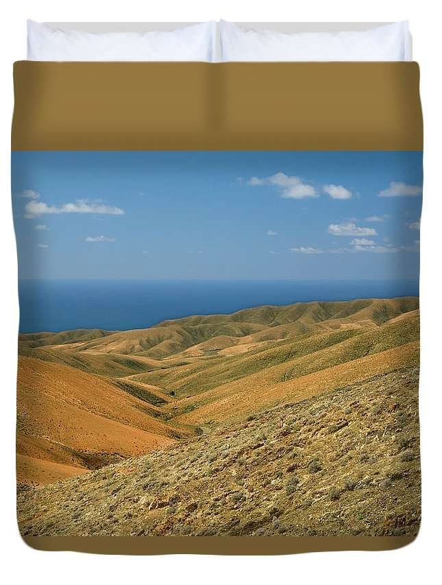 Scenics Duvet Cover featuring the photograph The Barren Hills Of Western by Roel Meijer