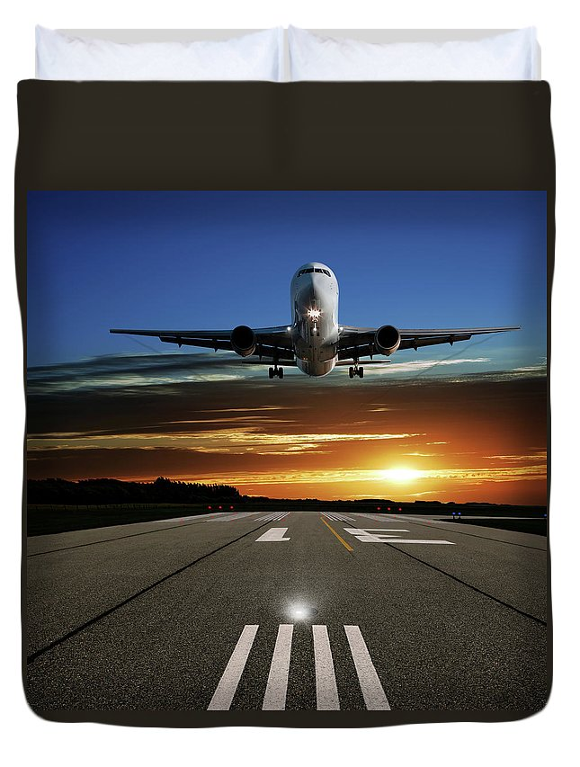 Orange Color Duvet Cover featuring the photograph Xl Jet Airplane Landing At Sunset by Sharply done