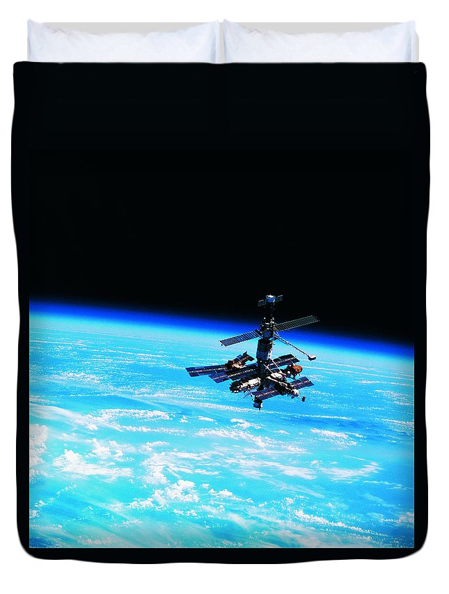 Alertness Duvet Cover featuring the photograph A Space Station Orbiting Above Earth by Stockbyte