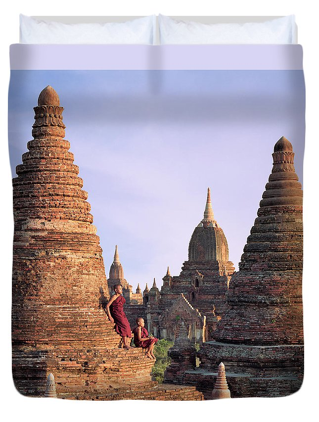 Child Duvet Cover featuring the photograph Myanmar, Bagan, Buddhist Monks On Temple by Martin Puddy