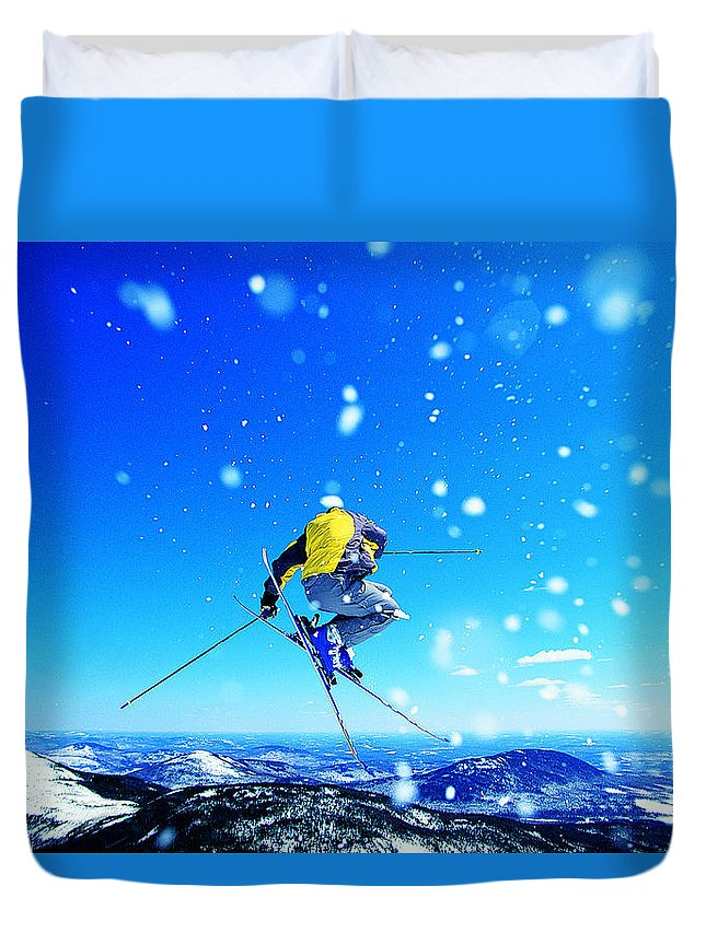 Skiing Duvet Cover featuring the photograph Man Skiing by Digital Vision.
