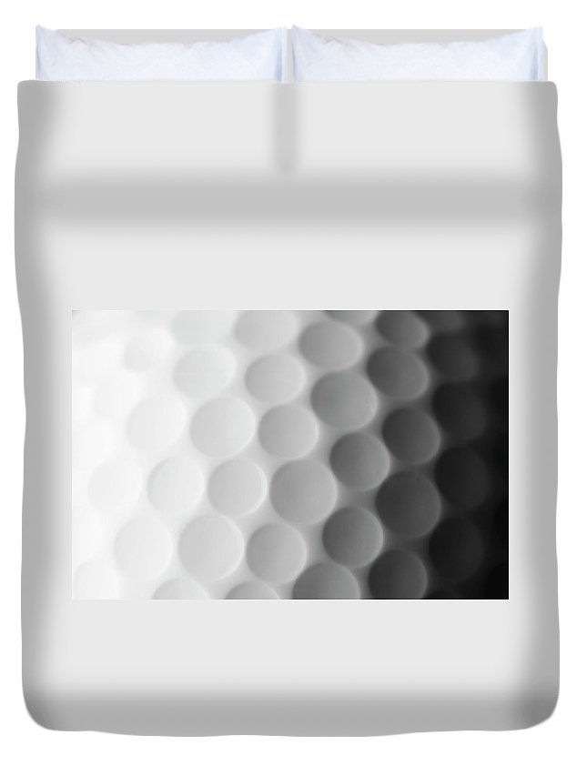 Ball Duvet Cover featuring the photograph A Close Up Shot Of A Golf Ball, White by Anthiacumming