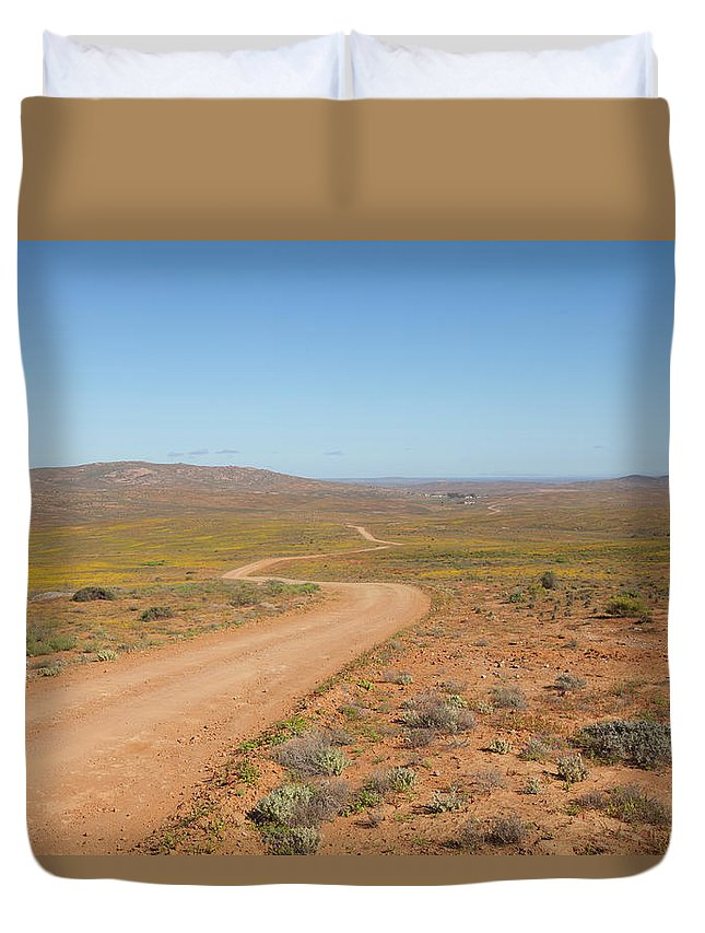 Outdoors Duvet Cover featuring the photograph A Dirt Road Winds Through The Barren by Anthony Grote