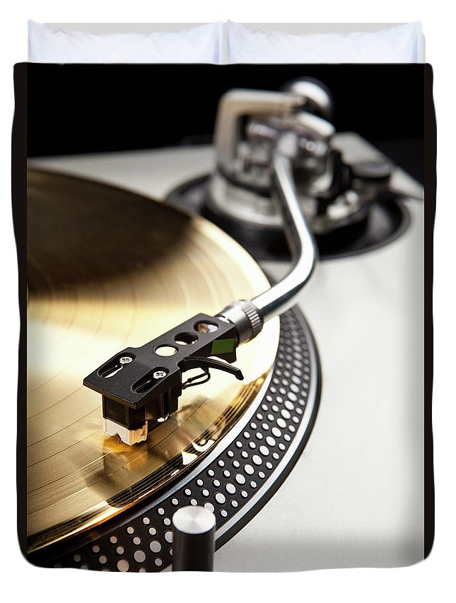 Music Duvet Cover featuring the photograph A Gold Record On A Turntable by Caspar Benson