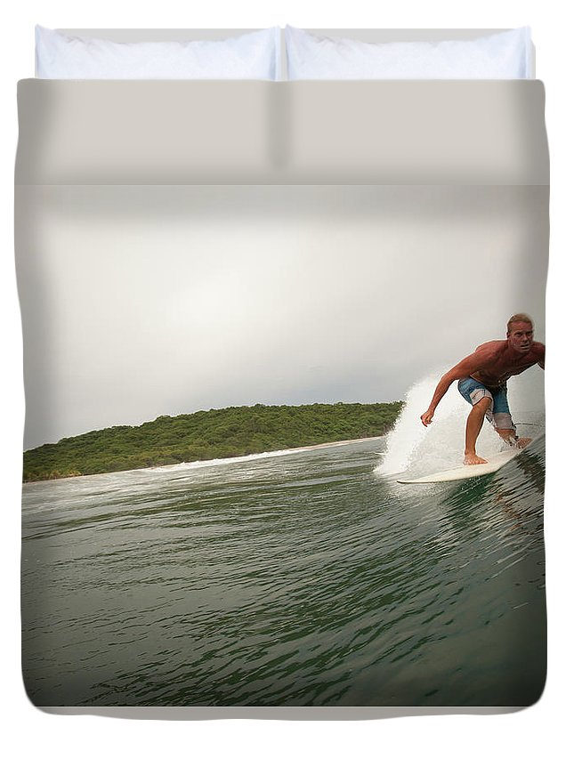 Focus Duvet Cover featuring the photograph A Male Surfer In A Barrel Of A Wave In by Sean Murphy