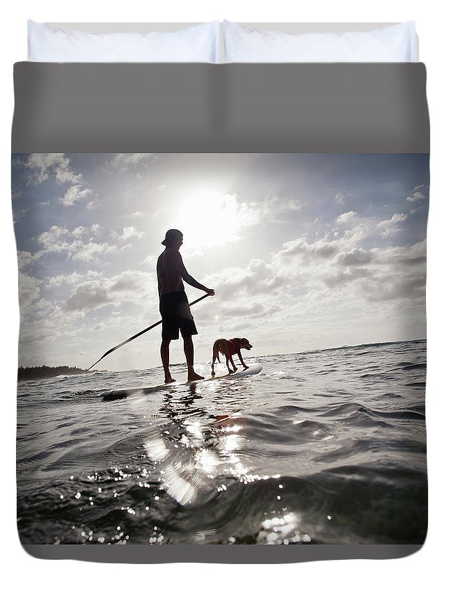 Pets Duvet Cover featuring the photograph A Man And His Dog On A Stand Up Paddle by Noel Hendrickson