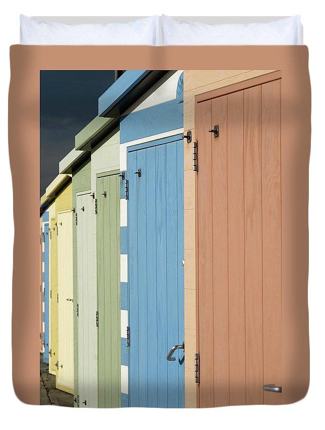 Beach Hut Duvet Cover featuring the photograph A Row Of Beach Huts by Matthew Piper