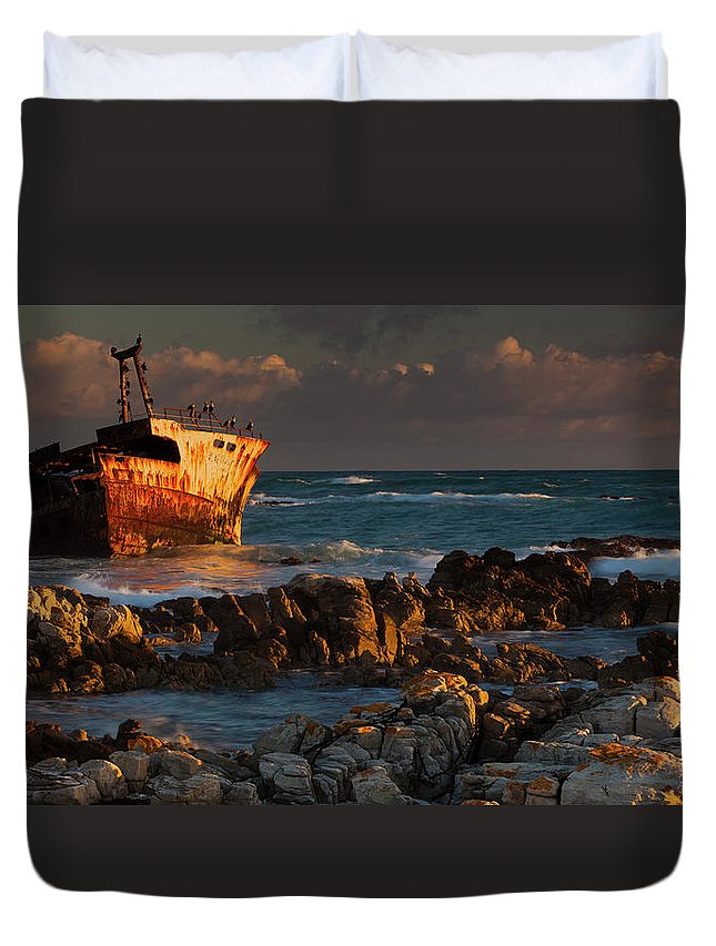 Non-urban Scene Duvet Cover featuring the photograph A Rusting Wreck, An Abandoned Ship Off by Mint Images - Art Wolfe