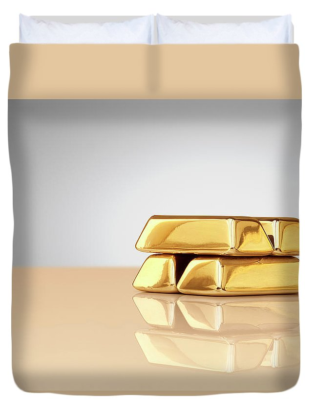 Four Objects Duvet Cover featuring the photograph A Stack Of Four Gold Ingots by Anthony Bradshaw