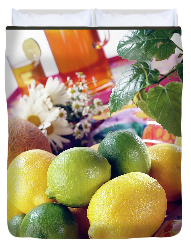 Close-up Duvet Cover featuring the photograph A Summer Table Setting With Lemons And by Steve Wisbauer