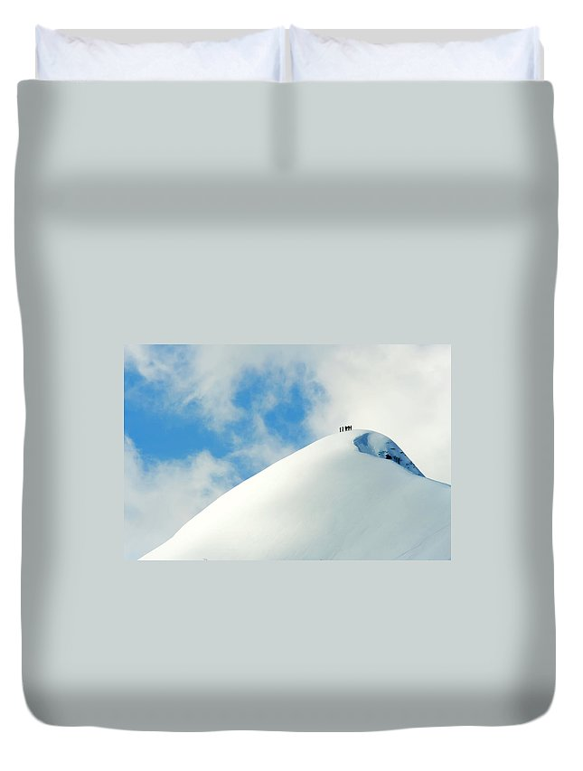 The End Duvet Cover featuring the photograph A Team Of People Climbing A Snowy by Lopurice