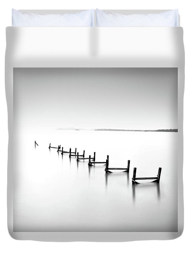 Tranquility Duvet Cover featuring the photograph Abandond Jetty by Photography By Azrudin