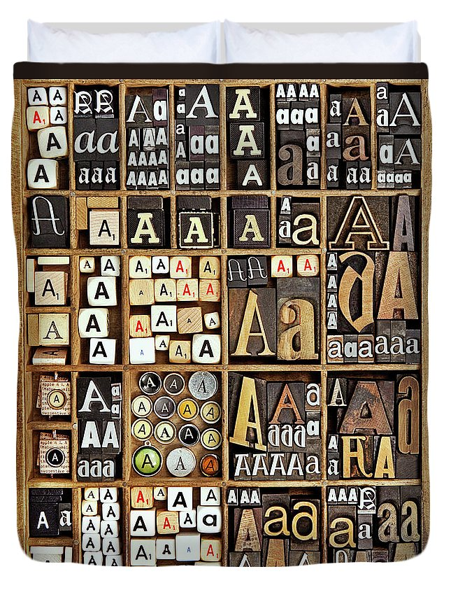 In A Row Duvet Cover featuring the photograph Alphabet by Daryl Benson