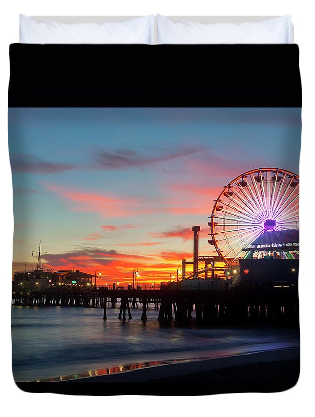 Scenics Duvet Cover featuring the photograph Amusement Park On Waterfront At Night by Blend Images/pete Saloutos