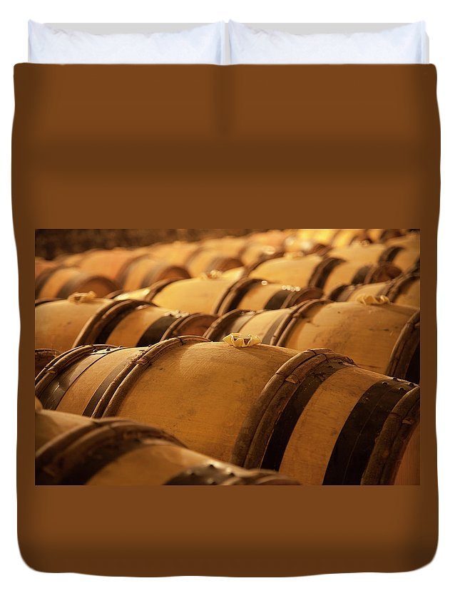 Fermenting Duvet Cover featuring the photograph An Old Wine Cellar Full Of Barrels by Brasil2