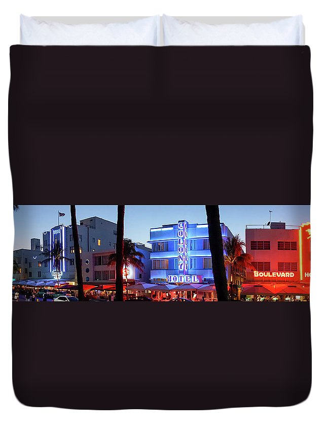 Panoramic Duvet Cover featuring the photograph Art Deco Hotels On Ocean Drive At Dusk by Buena Vista Images