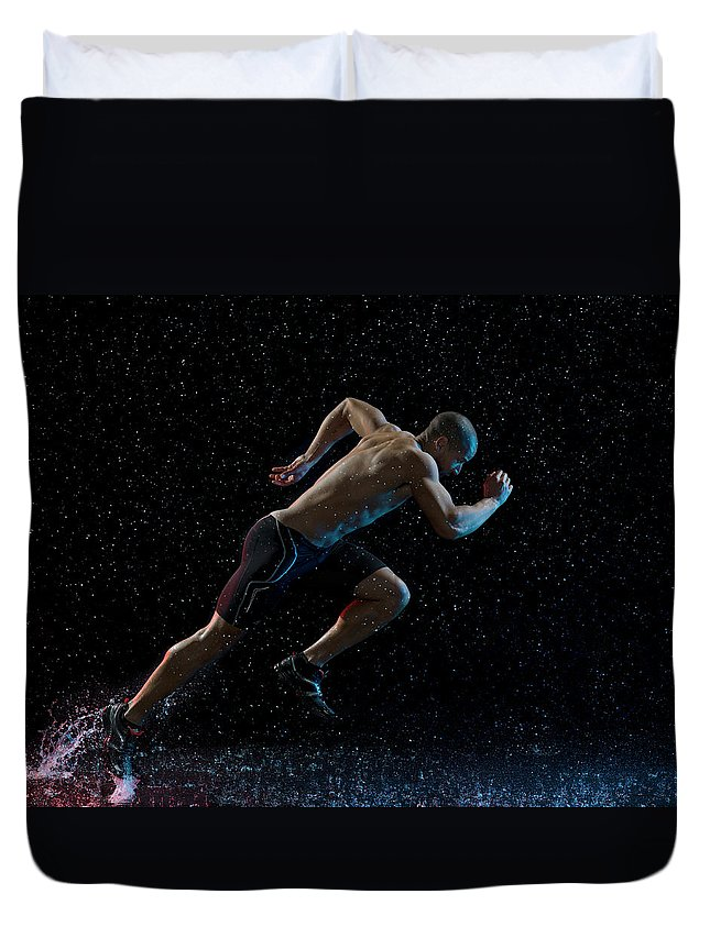 People Duvet Cover featuring the photograph Athlete Runner Running Through Rain by Jonathan Knowles