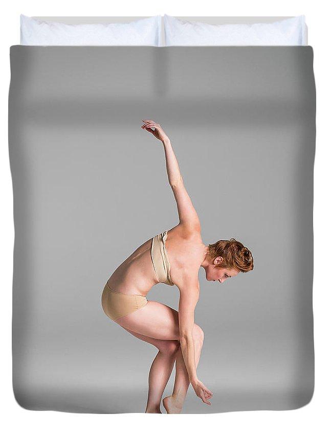 Ballet Dancer Duvet Cover featuring the photograph Ballerina In Studio Dancing by Nisian Hughes